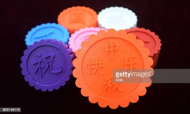 3D printed moon cakes are displayed at the mechanical engineering academy of Yangzhou University on September 12 2016 in Yangzhou Jiangsu Province of...