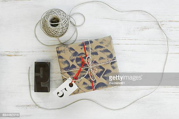 Printed packing paper, stamp, cord, packet