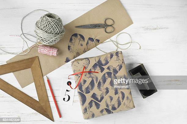 Printed packing paper, triangle, stamp, cord, packet