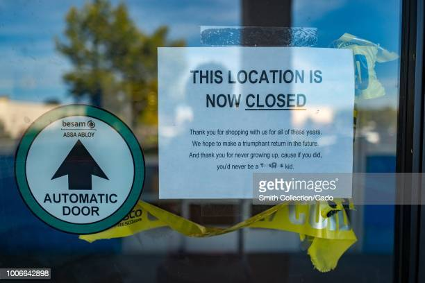 Printed paper sign on door of Toys R Us store in Dublin California following the company's bankruptcy with yellow caution tape and text reading Thank...