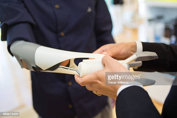 A 3D printed prostehetic arm is fitted to a potential user on September 21 2015 in Okayama Japan The prosthetic arm 'Finch' that can be massproduced...