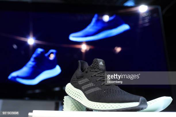 A 3D printed sole sits on an Adidas AG Futurecraft 4D trainer during the company's annual results announcement in Herzogenaurach Germany on Wednesday...