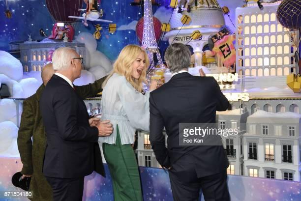 Printemps CEO Paolo Cesare actress Nicole Kidman and general director LVMH Antonio Belloni attend the 'Le Printemps' Christmas Decorations...