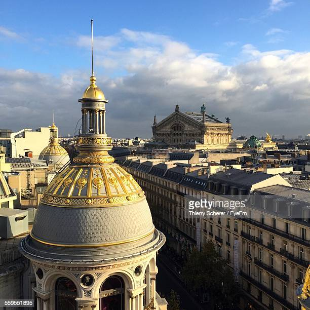 printemps shopping mall and palais garnier against cloudy sky - dome stock pictures, royalty-free photos & images