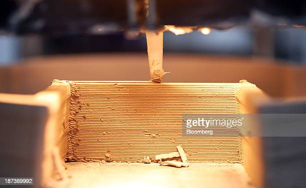 A 3D printer builds a bee house using liquefied clay during the 3D Print show at the Business Design Center in London UK on Friday Nov 8 2013...