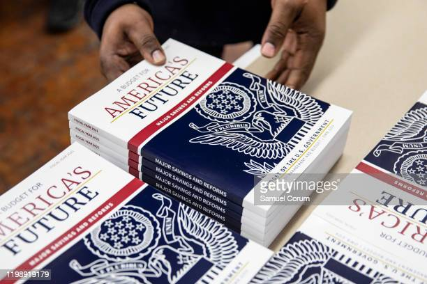 Printer loads sections of US President Donald Trump's proposed budget for the US Government for the 2021 Fiscal Year onto a cart at the Government...
