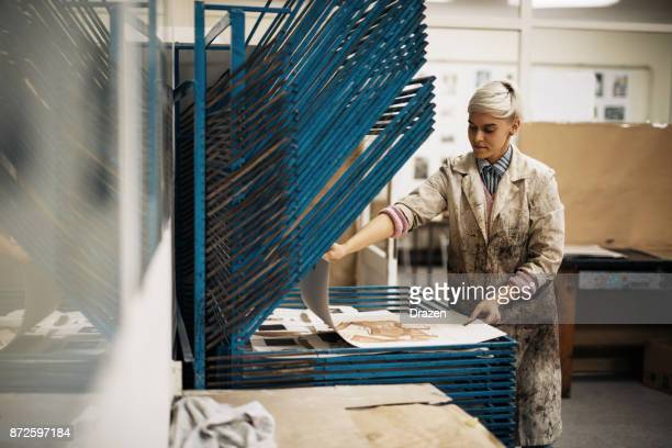 printing and etching - artis ti drying new etching print - intaglio stock pictures, royalty-free photos & images