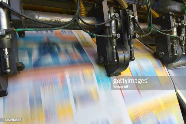 printing machine in a printing shop - publisher stock pictures, royalty-free photos & images