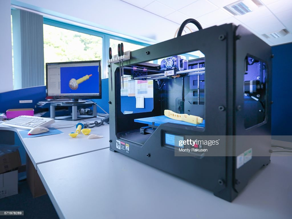 3D printing machine with CAD design on screen in orthopaedic factory : Stock Photo