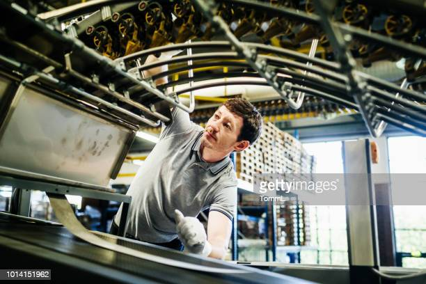 printing machinery being repaired by engineer - printing plant stock pictures, royalty-free photos & images