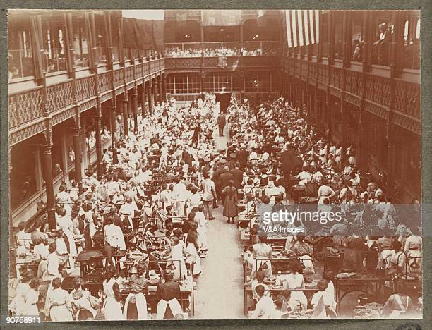 Printing out paper print Photograph by Horace W Nicholls of the visit of King George V and Queen Mary to a factory manufacturing soldiers' uniforms