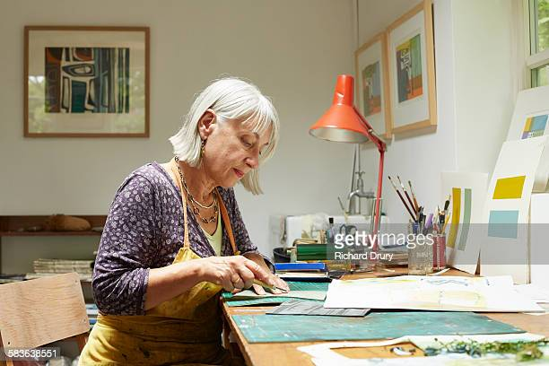 printmaker cutting lino print block - craft stock pictures, royalty-free photos & images