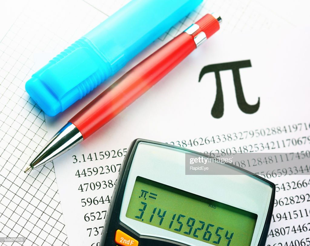 printout pens and calculator calculating value of pi stock photo