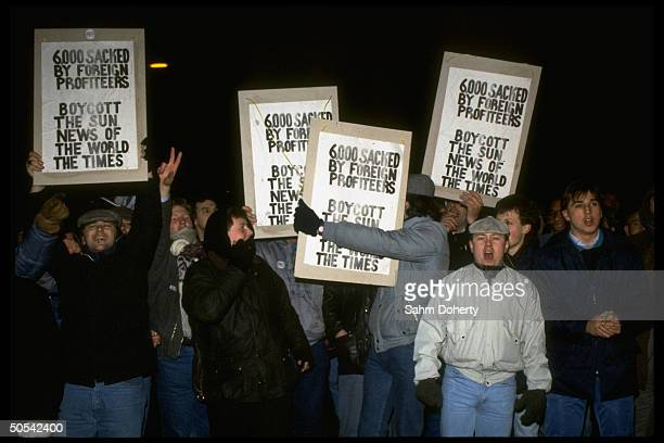 Printworkers demontrating on picket line outside newspaper owner Rupert Murdoch's Wapping London plant during strike