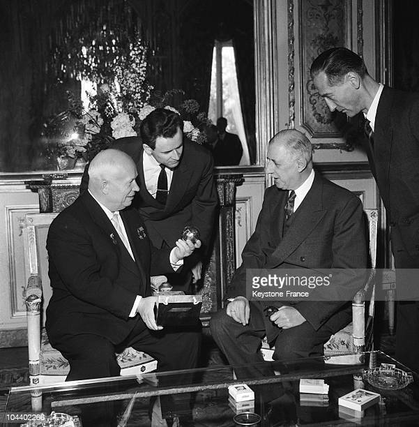 Prior to a luncheon organized by General DE GAULLE Nikita KHRUSHCHEV presents him with small replica of the LUNIK one of the first Soviet spaceships...