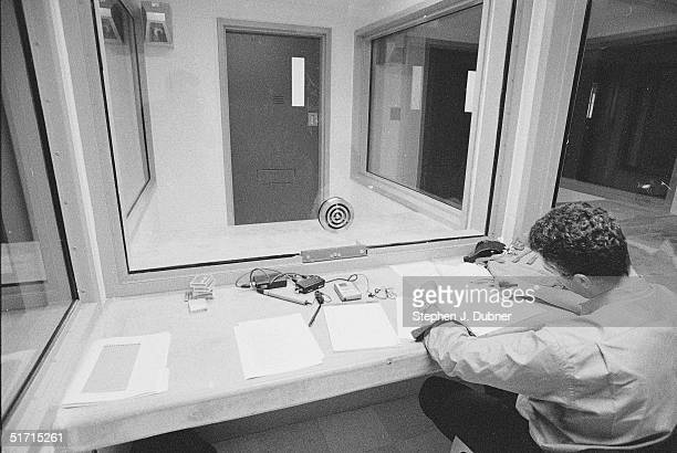 **EXCLUSIVE** Prior to an interview with prisoner Ted Kaczynski a man looks over notes in a visiting room at the Federal ADX Supermax prison in...