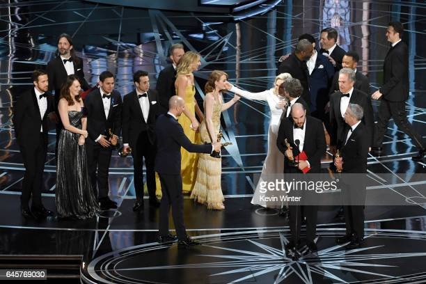 Prior to learning of a presentation error, 'La La Land' producers Fred Berger, Jordan Horowitz and Marc Platt accept the Best Picture award for 'La...