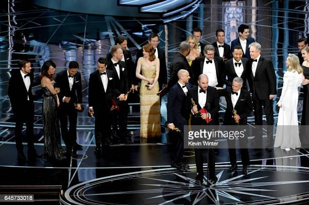 Prior to learning of a presentation error 'La La Land' producers Jordan Horowitz Fred Berger and Marc Platt accept the Best Picture award for 'La La...