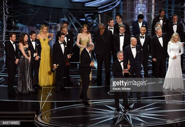 Prior to learning of a presentation error 'La La Land' producers Marc Platt Jordan Horowitz and Fred Berger accept the Best Picture award for 'La La...
