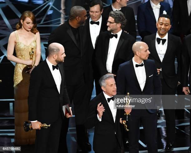 Prior to learning of a presentation error 'La La Land' producers Marc Platt Jordan Horowitz and Fred Berger accept the Best Picture award for 'La La...