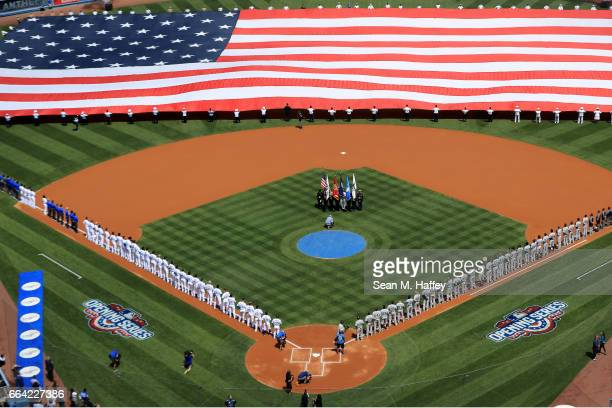 Prior to Opening Day game the Los Angeles Dodgers and San Diego Padres stand during the national anthem at Dodger Stadium on April 3 2017 in Los...