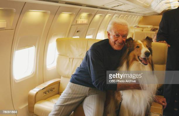 Prior to takeoff American animal actor Howard best known as Lassie poses with American television personality and game show host Bob Barker on a...