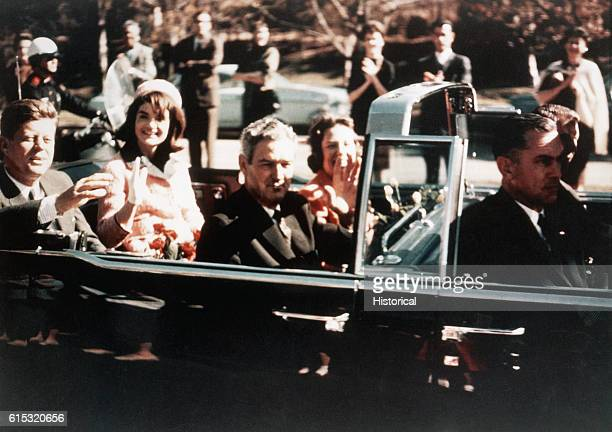 Prior to the assassination President John F Kennedy First Lady Jacqueline Kennedy and Texas Governor John Connally ride through the streets of Dallas...