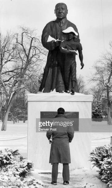 Prior to the beginning of the parade Floyd Simmons took a closer look at the Martin Luther King Statue in city park Credit The Denver Post