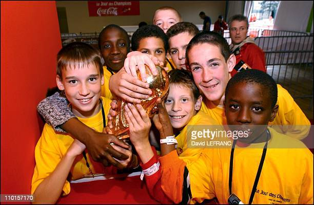 Prior to the France/Belgium friendly game 2002 children form all parts of France form a giant heart to wish the team good luck before they leave for...