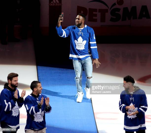 TORONTO ON DECEMBER 10 Prior to the start of the game TFCs Jozy Altadore comes out for the ceremonial puck drop and takes a selfie while doing it...