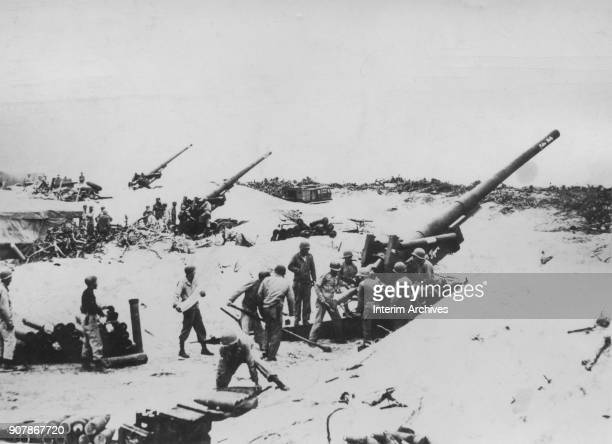 Prior to the Tenth Army assault landing the 420th Field Artillery Group set up 155mm guns on Keise Shima Okinawa Japan March 28 1945