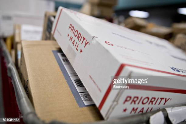 A priority mail package sits in a bin before delivery at the United States Postal Service Joseph Curseen Jr and Thomas Morris Jr processing and...