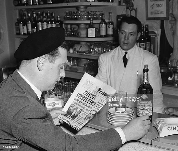 A Pris bartender is at the ready in case his customer feels the need of more consolation as he studies his morning newspaper Each saucer represents a...
