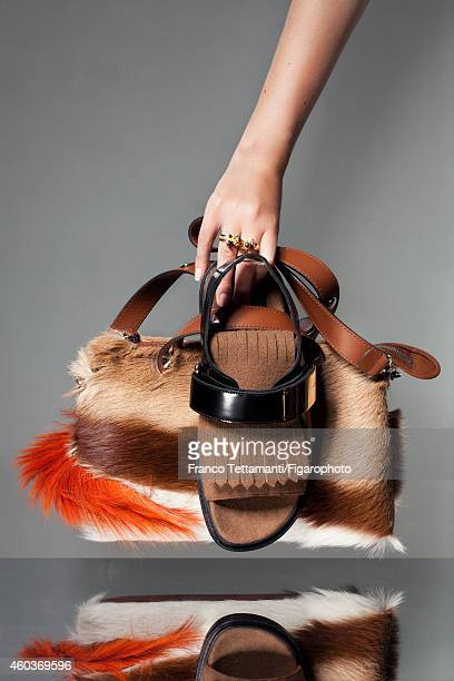 Prisca and Virginie CourtinClarins' style inspirations are photographed for for Madame Figaro on July 9 2014 in Paris France Bag sandal rings...