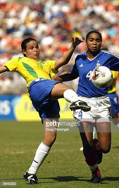 Priscila of Brazil kicks the ball away from Laura Georges of France during First Round action in Group B of the 2003 FIFA Women's World Cup on...
