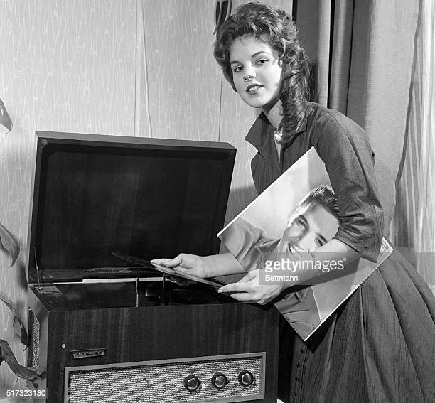 Priscilla Beaulieu Elvis Presley's 'girl back home' plays a record album by the teen idol Elvis was serving in the US Army in Germany The couple were...