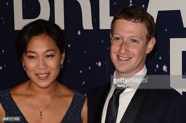 Priscilla Chan and Mark Zuckerberg attend the 2014 Breakthrough Prize Awards at NASA AMES Research Center on November 9 2014 in Mountain View...