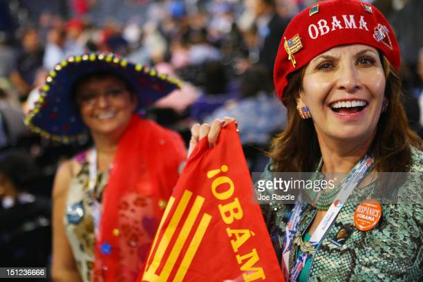 Priscilla Chavez of Las Cruces NM and Carla Arellanes of Las Vegas NM wear a decorated hats during day one of the Democratic National Convention at...