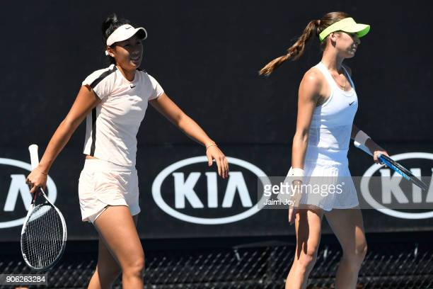 Priscilla Hon of Australia and Ajla Tomljanovic of Australia talk tactics in their first round women's doubles match against Barbora Krejcikova of...