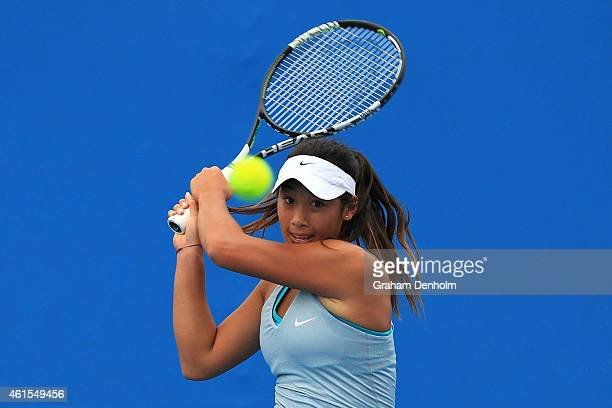 Priscilla Hon of Australia plays a backhand in her qualifying match against Evgeniya Rodina of Russia for the 2015 Australian Open at Melbourne Park...