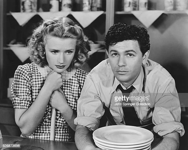 Priscilla Lane and John Garfield consider their future in this scene from the 1939 motion picture Dust Be My Destiny
