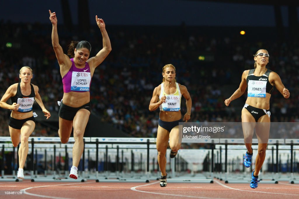 Priscilla Lopes-Schliep (2nd l) of Canada celebrates victory in the women's 100m hurdles from Lolo Jones (r) of USA during the Iaaf Diamond League meeting at the Letzigrund Stadium on August 19, 2010 in Zurich, Switzerland.