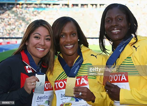 Priscilla LopesSchliep of Canada receives the silver medal Brigitte FosterHylton of Jamaica the gold medal and Delloreen EnnisLondon of Jamaica the...