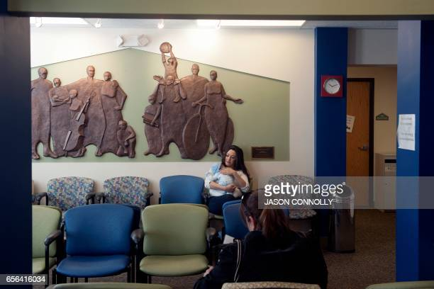 Priscilla Martinez sits with her three week old son Elias in the waiting room at Inner City Health Center in Denver Colorado on March 15 2017 Inner...