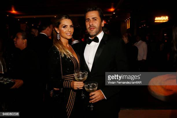 Priscilla Nunes and Tiago Escher attend the 2018 amfAR gala Sao Paulo at the home of Dinho Diniz on April 13 2018 in Sao Paulo Brazil