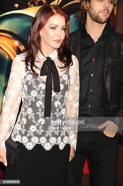 """Priscilla Presley and musician Navarone Garibaldi arrive at the premiere of """"Mad Max: Fury Road"""" held at the TCL Chinese Theater in Hollywood."""