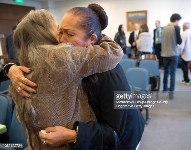 Priscilla Vargas mother of murder victim Josephine Vargas right hugs Diane Menzies grandmother of murder victim Kianna Jackson after Steven Gordon...