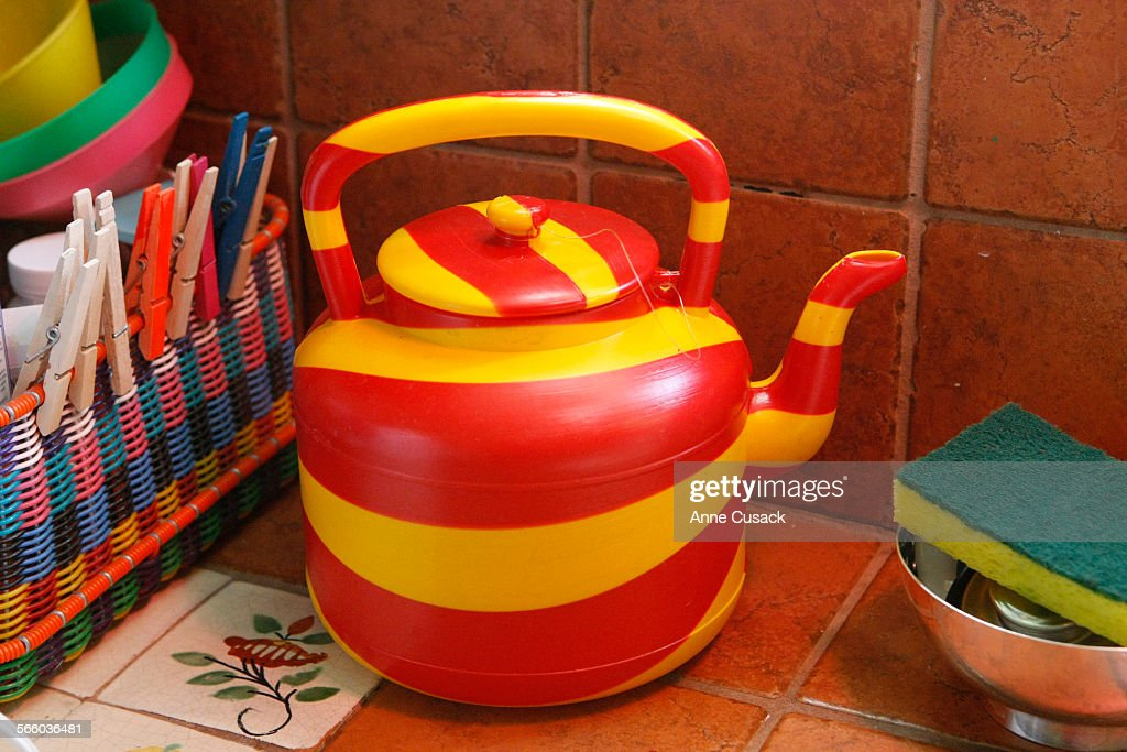 Priscilla Woolworth keeps an African tea kettle by the sink in the ...