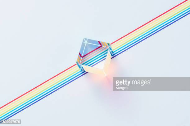 prism on colorful lines - data stream stock photos and pictures