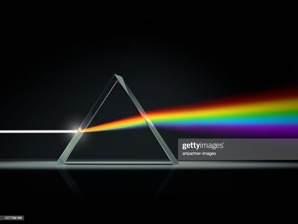 Prism splitting light into color spectrum : Stock Photo